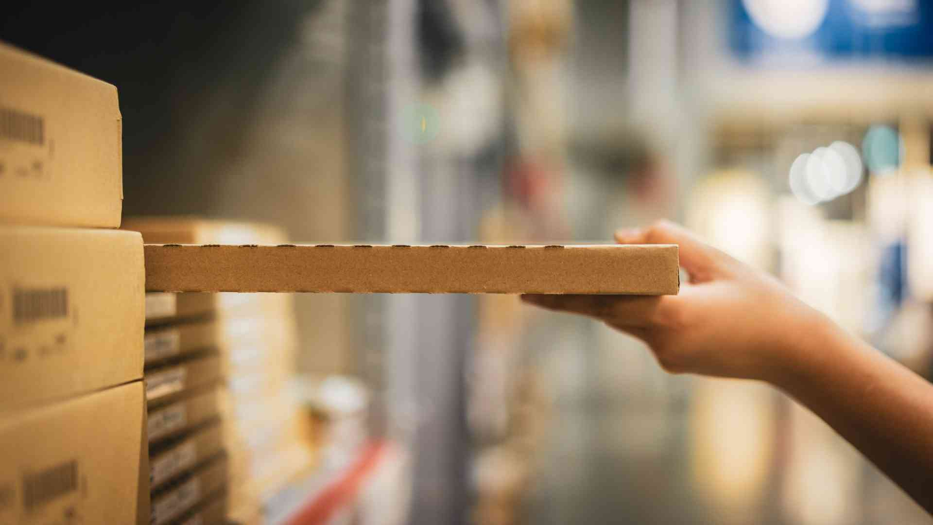 Woman Picking Product From Shelf Warehouse Inventory