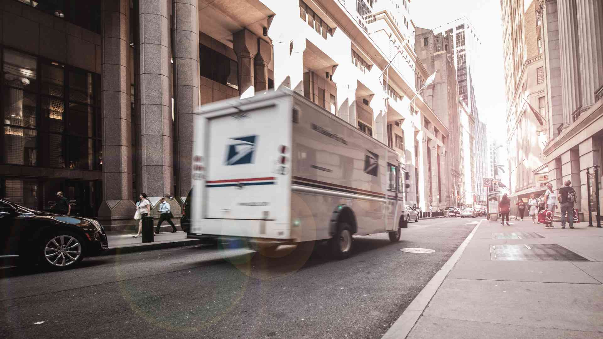 USPS truck delivering online shopping package