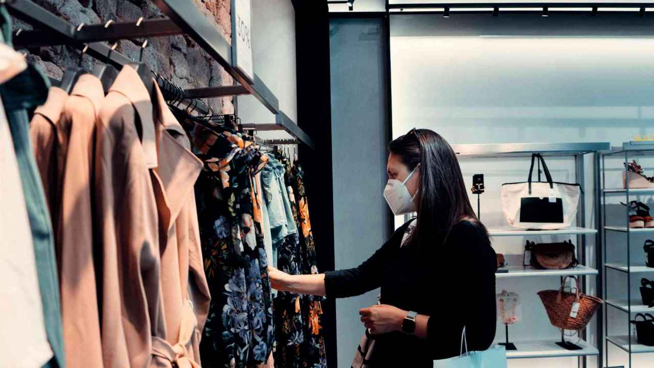 Female shopper in apparel store Unified Commerce