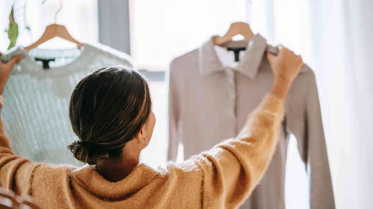 Woman Comparing Clothes Sales Channel Integration